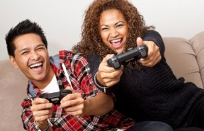 A man and a woman playing a video game.